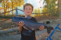 Cooper Maio with his 25 pound blue catfish caught at Lake Jennings near the T-dock.