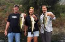 John Kerr, Mitzi Turner, and Jordan Kerr with 3 of the 4 bass in one of many quadruple hookups on the opening day