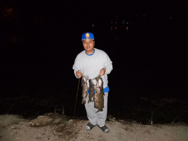 Mike Saluphiu with a stringer of Santee Lakes catfish