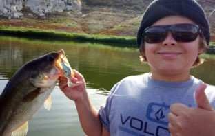 Young angler with a Barrett bass caught on a Rapala crankbait