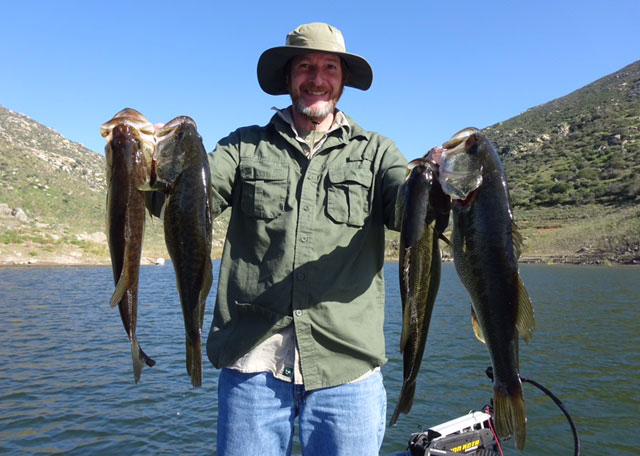 Chris White of Massachusetts displays some nice bass caught at El Capitan on a guide trip with Jim Hallauer