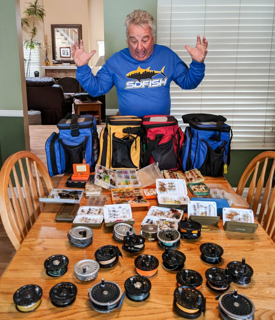 Jim Brown organizes his fishing tackle